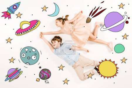 top view of cheerful kids gesturing while flying in space