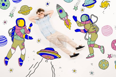cute kid with hands near eyes flying in space near astronauts on white