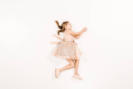 Photo for Cute kid smiling and gesturing while lying on white - Royalty Free Image