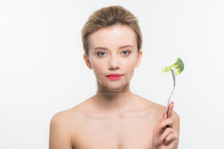 Photo for Attractive naked woman holding fork with green ripe broccoli isolated on white - Royalty Free Image