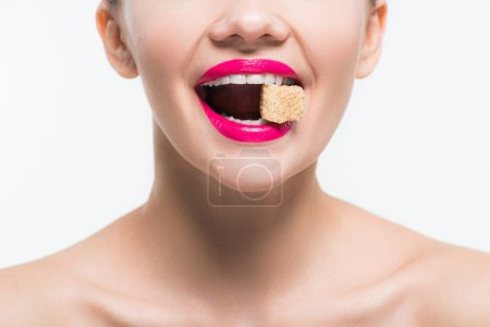 Photo for Cropped view of cheerful woman eating sugar cube isolated on white - Royalty Free Image