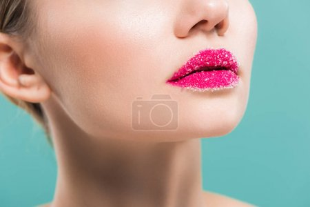 Photo for Cropped view of young woman with sugar on lips isolated on blue - Royalty Free Image
