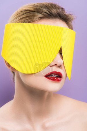Photo pour Young woman with red lips in yellow paper glasses isolated on purple - image libre de droit