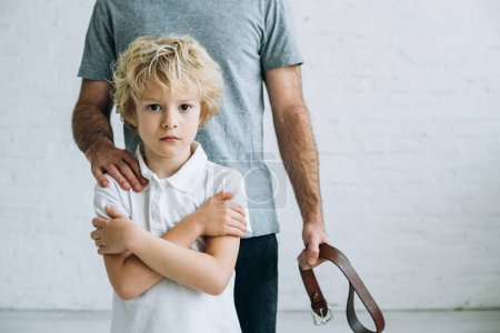 Photo for Cropped view of father and son having conflict at home - Royalty Free Image