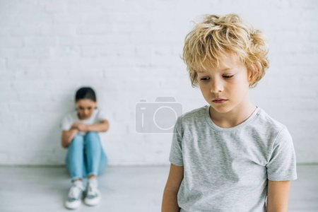 Photo for Sad preteen brother and sister in t-shirts at home - Royalty Free Image