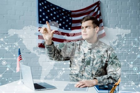 Foto de Handsome man in military uniform gesturing near data visualization - Imagen libre de derechos