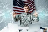 "Постер, картина, фотообои ""cheerful man in military uniform pointing with fingers at data visualization"""