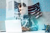 "Постер, картина, фотообои ""handsome soldier in camouflage uniform using laptop in office near data visualization"""
