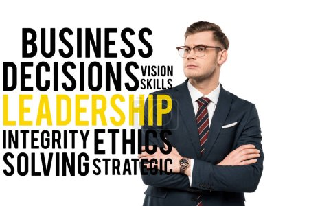 handsome businessman standing with crossed arms near business decisions vision skills leadership integrity ethics solving strategic lettering on white