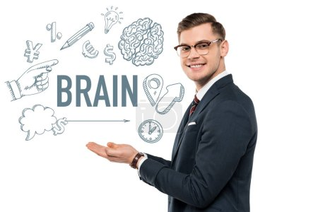 happy businessman in glasses gesturing and smiling near brain lettering on white