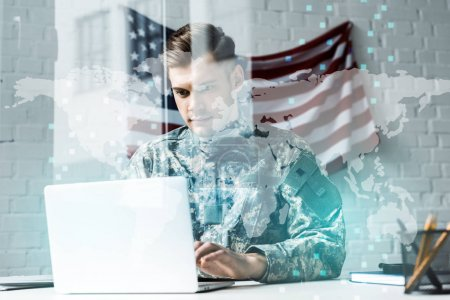 Photo for Soldier in camouflage uniform using laptop in office near data visualization - Royalty Free Image