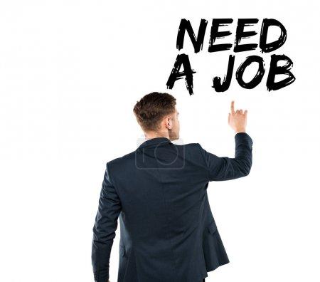 Photo pour Vue arrière de l'homme pointant avec le doigt au besoin un lettrage de travail isolé sur blanc - image libre de droit