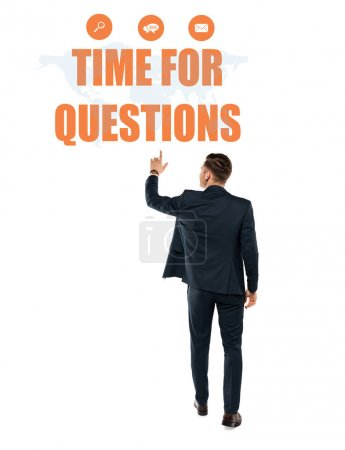 Photo for Back view of man pointing with finger at time for questions lettering while standing on white - Royalty Free Image