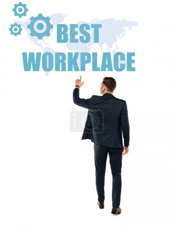 Photo pour Vue arrière de l'homme pointant avec le doigt au meilleur lettrage de lieu de travail tout en restant isolé sur le blanc - image libre de droit
