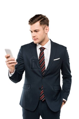 Foto de Handsome businessman in suit looking at smartphone isolated on white - Imagen libre de derechos