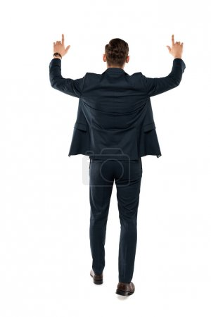 Photo for Back view of businessman pointing with fingers while standing isolated on white - Royalty Free Image