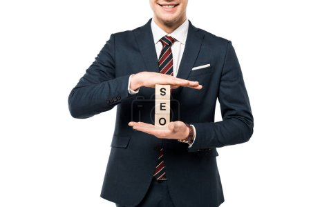 Photo for Cropped view of happy businessman holding wooden cubes with seo lettering isolated on white - Royalty Free Image