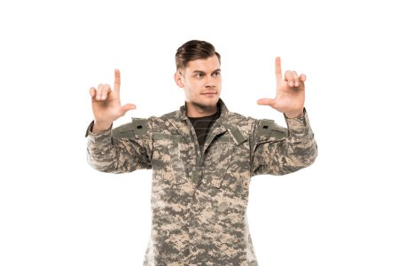 Photo for Handsome man in military uniform pointing with fingers isolated on white - Royalty Free Image