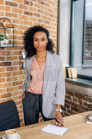 Photo for Beautiful african american Casual businesswoman looking at camera in loft office - Royalty Free Image