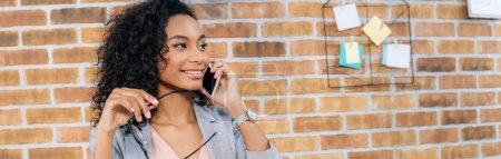 Photo for Panoramic shot of african american Casual businesswoman talking on smartphone - Royalty Free Image