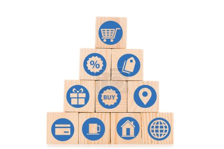 Photo for Pyramid made of wooden blocks with blue shopping icons isolated on white - Royalty Free Image