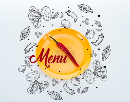 Photo for Top view of red chili pepper on bright yellow plate with menu lettering on white background - Royalty Free Image