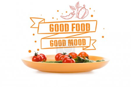 Photo pour Tomates cerises avec des feuilles vertes d'épinards dans l'assiette jaune avec le lettrage de bonne humeur de nourriture au-dessus d'isolement sur le blanc - image libre de droit