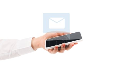 cropped view of woman holding smartphone with mail sign above isolated on white