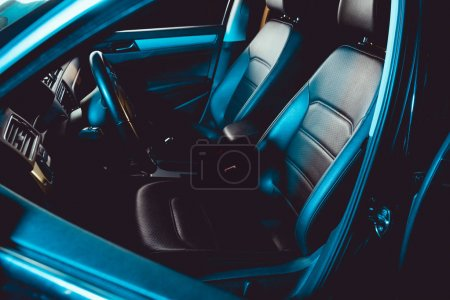 Photo for Car interior with steering wheel and seats in luxury auto - Royalty Free Image