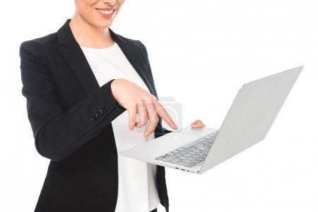 Photo pour Partial view of smiling mixed race businesswoman using laptop isolated on white - image libre de droit
