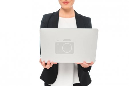 Photo for Cropped view of smiling mixed race businesswoman using laptop isolated on white - Royalty Free Image