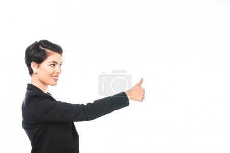 Photo for Pretty mixed race businesswoman smiling and showing thumb up isolated on white - Royalty Free Image