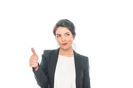 Photo for Smiling mixed race businesswoman showing thumb up and looking up isolated on white - Royalty Free Image
