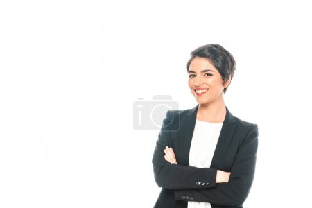 Photo for Cheerful mixed race businesswoman standing with crossed arms and smiling at camera isolated on white - Royalty Free Image