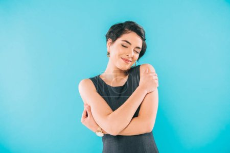 Photo for Beautiful mixed race woman posing at camera with closed eyes isolated on blue - Royalty Free Image