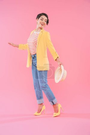 Photo for Attractive mixed race woman in bright clothing posing at camera on pink background - Royalty Free Image