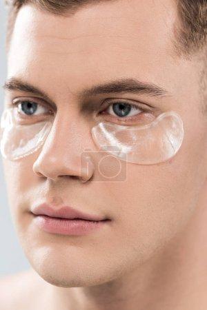 Foto de Portrait of handsome young man with eye patches looking away - Imagen libre de derechos
