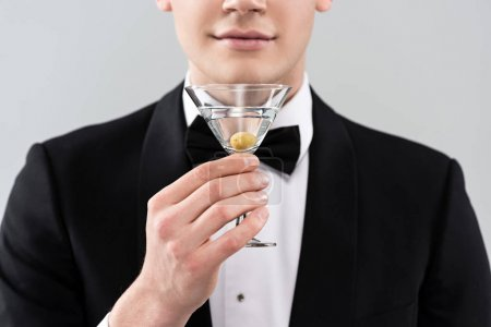Photo for Cropped view of smiling man in formal wear holding glass of cocktail isolated on grey - Royalty Free Image