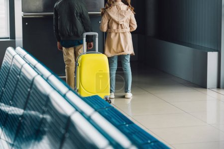 Photo for Back view of preteen children with suitcase in waiting hall - Royalty Free Image