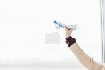 Photo for Cropped view of preteen kid holding toy plane with copy space - Royalty Free Image