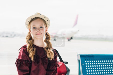 Photo for Adorable preteen kid looking at camera in airport - Royalty Free Image