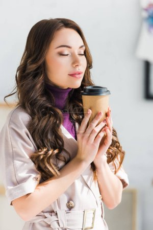 Photo for Attractive curly girl with closed eyes standing and holding paper cup - Royalty Free Image
