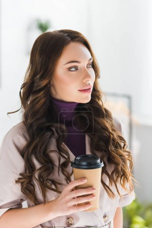 Photo for Dreamy curly young woman holding paper cup with coffee - Royalty Free Image