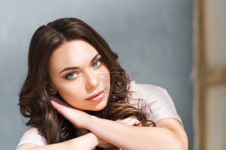 Photo for Dreamy young and curly woman looking at camera - Royalty Free Image