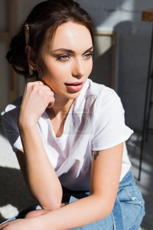 Photo for Pensive young woman in white t-shirt thinking at home - Royalty Free Image