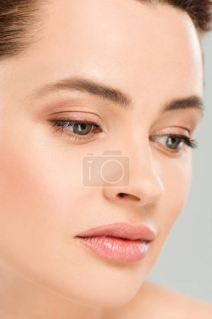 Photo for Close up of upset and attractive woman isolated on grey - Royalty Free Image