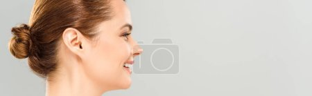 Photo for Panoramic shot of cheerful woman smiling isolated on grey - Royalty Free Image