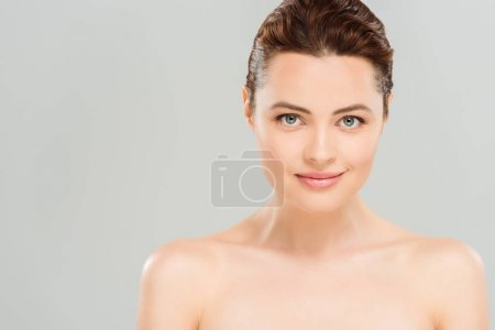 Photo for Nude and cheerful woman looking at camera isolated on grey - Royalty Free Image