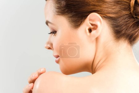Photo for Close up of cheerful woman touching shoulder isolated on grey - Royalty Free Image