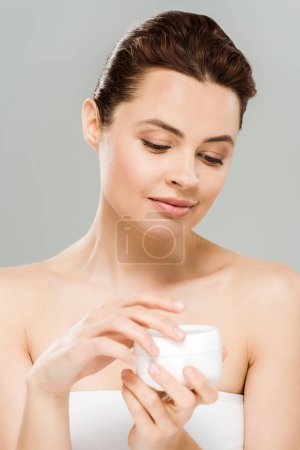 Photo for Woman holding container with face cream isolated on grey - Royalty Free Image